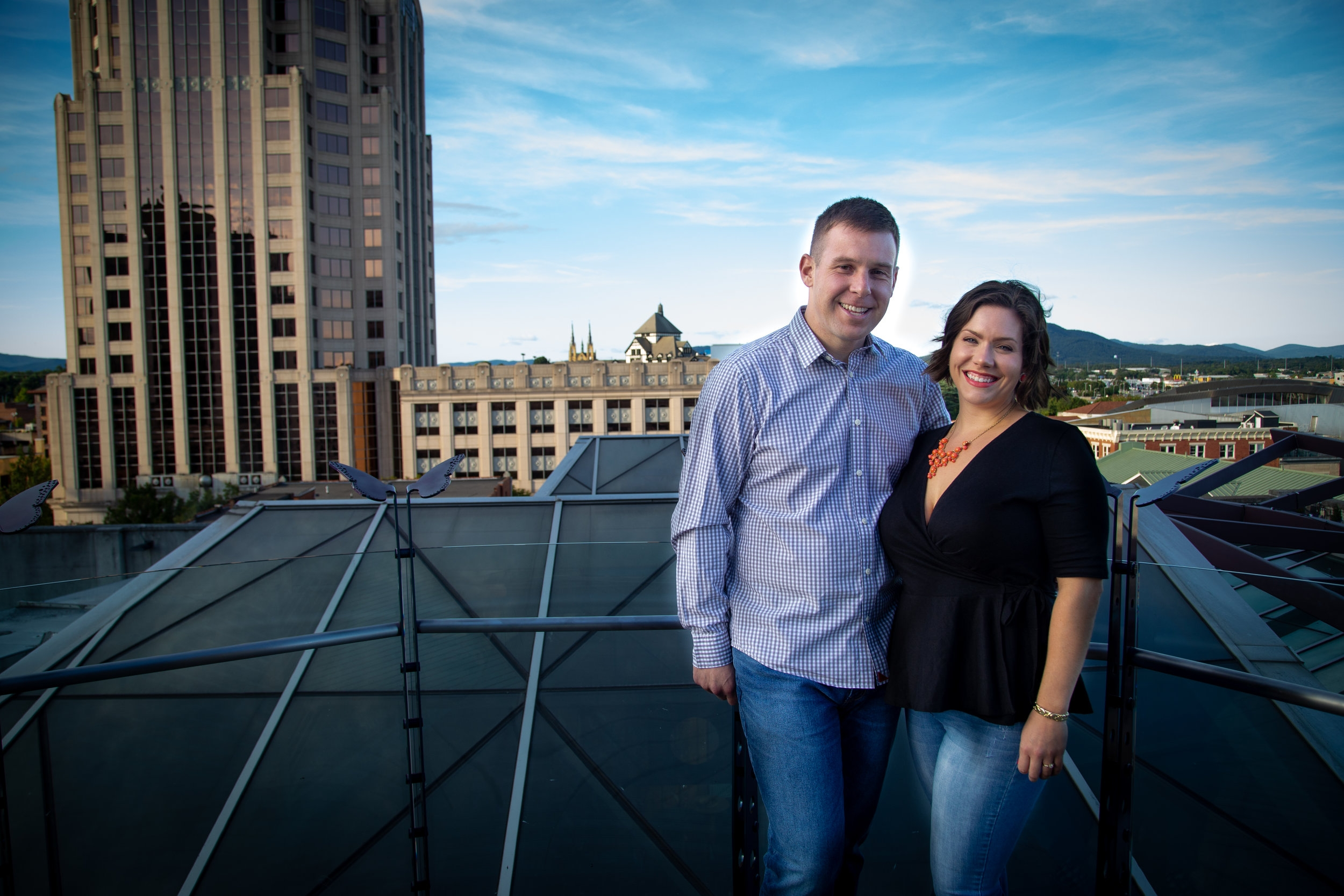 center-in-the-square-downtown-roanoke-urban-rooftop-engagment-wedding-wells-fargo-building-mountains-couple-love-engaged