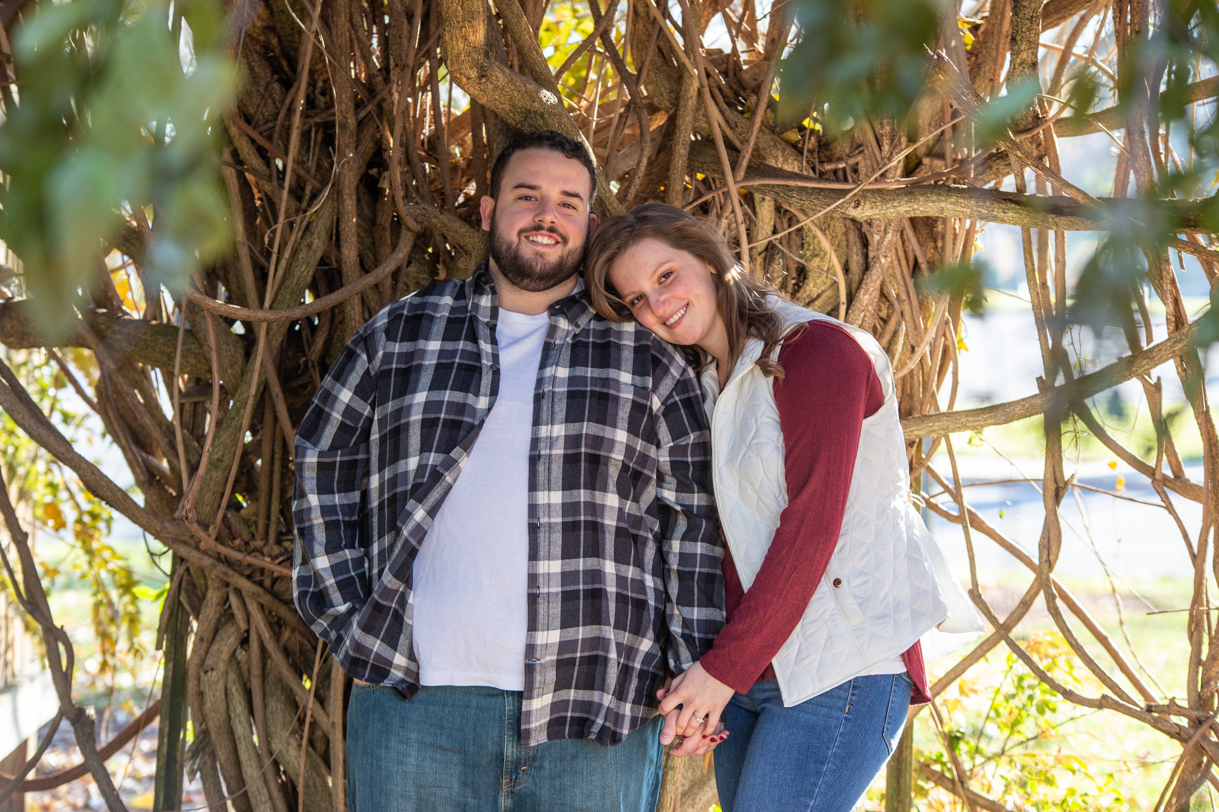 Fall-Vines-gaze-love-couple-shoot-photography-blacksburg-roanoke-love-lover-loving-engaged-wedding-Virginia-Tech-campus-framing-lean-bright