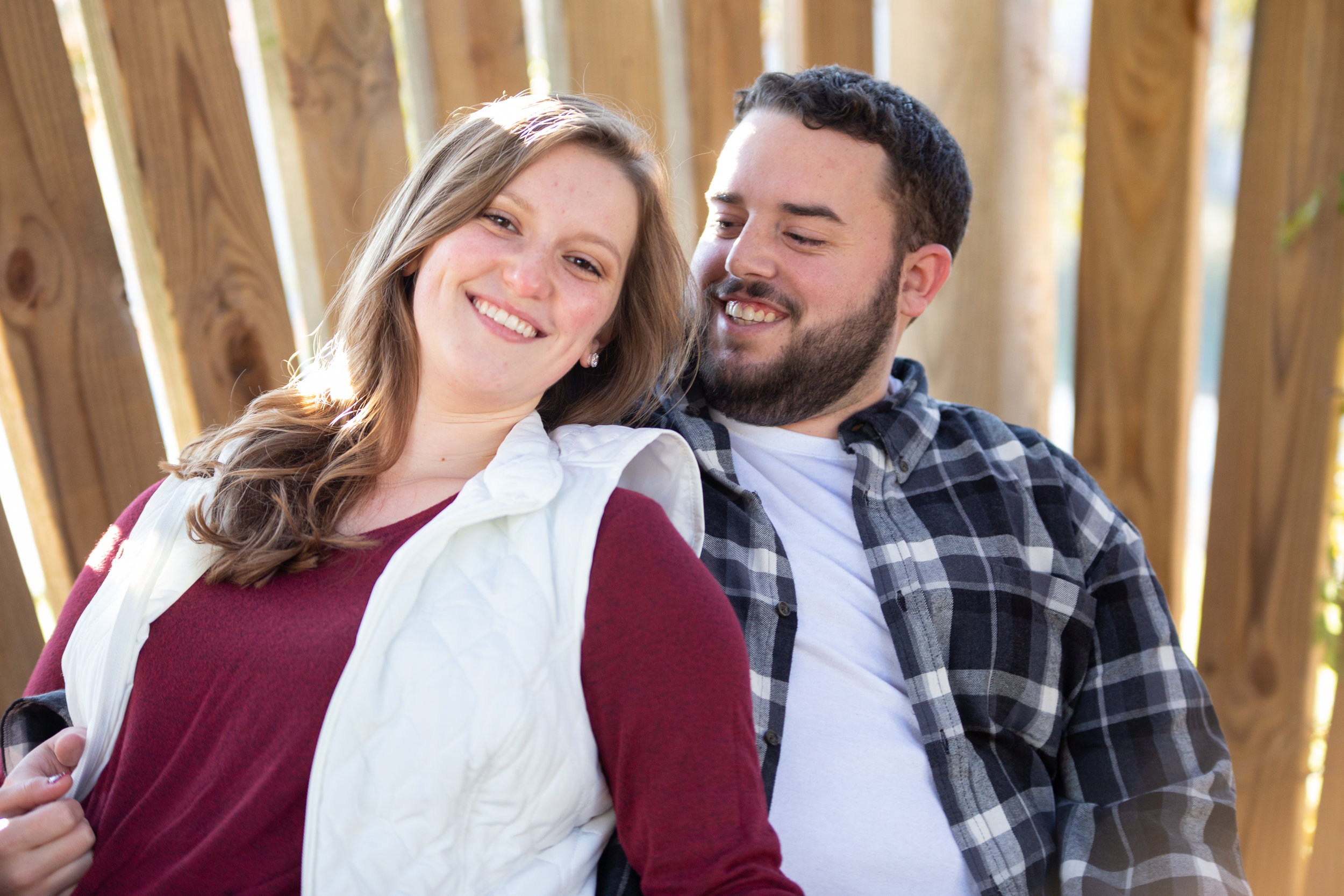 Fall-Vines-gaze-love-couple-shoot-photography-blacksburg-roanoke-love-lover-loving-engaged-wedding-Virginia-Tech-campus-slats-leaning-texture-smiling