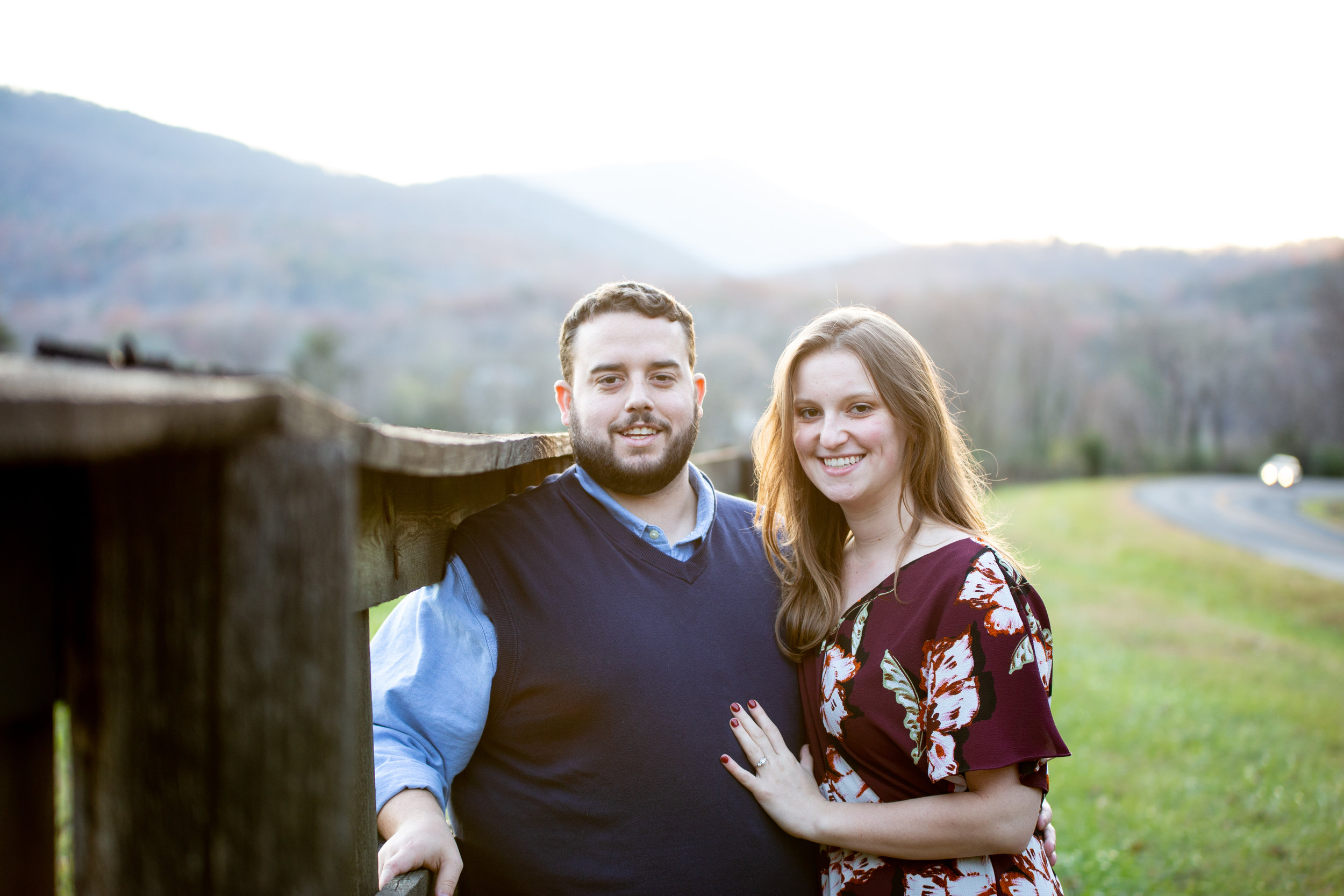 Blue-Ridge-Parkway-Fall-Sunset-couple-engaged-mountains-love-together-fence-roanoke-engaged-beauty-virginia-photography-nature-candid