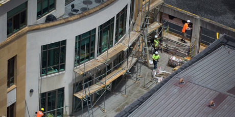 Contractors erect scaffolding at Chancery shopping centre in central Auckland in preparation for repair work. Photo / Sarah Ivey