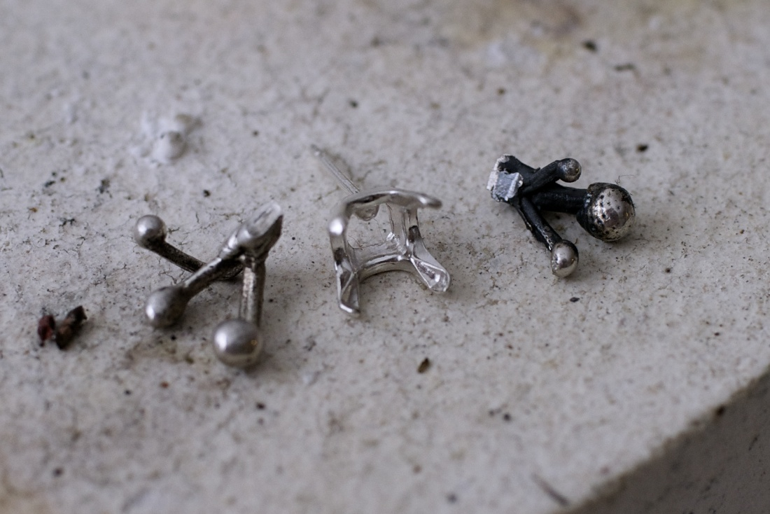 Small organic silver pieces from an earlier casting are cut to fit a stone setting.