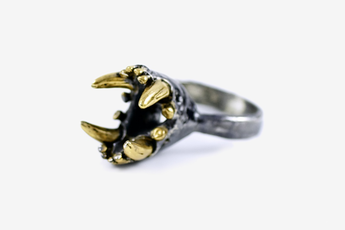 small jaws ring with gold detailing