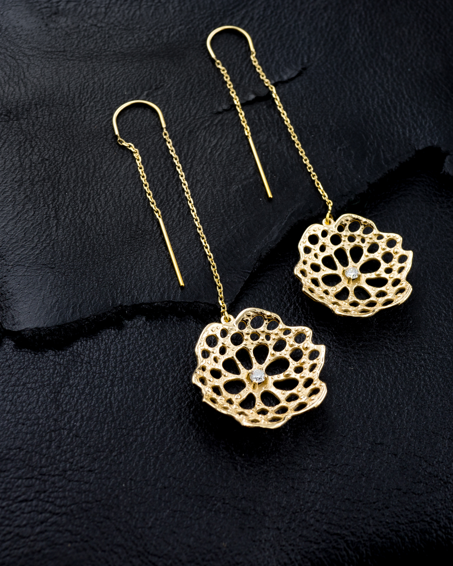 Beneath the Surface earrings: Yellow gold, white diamonds.