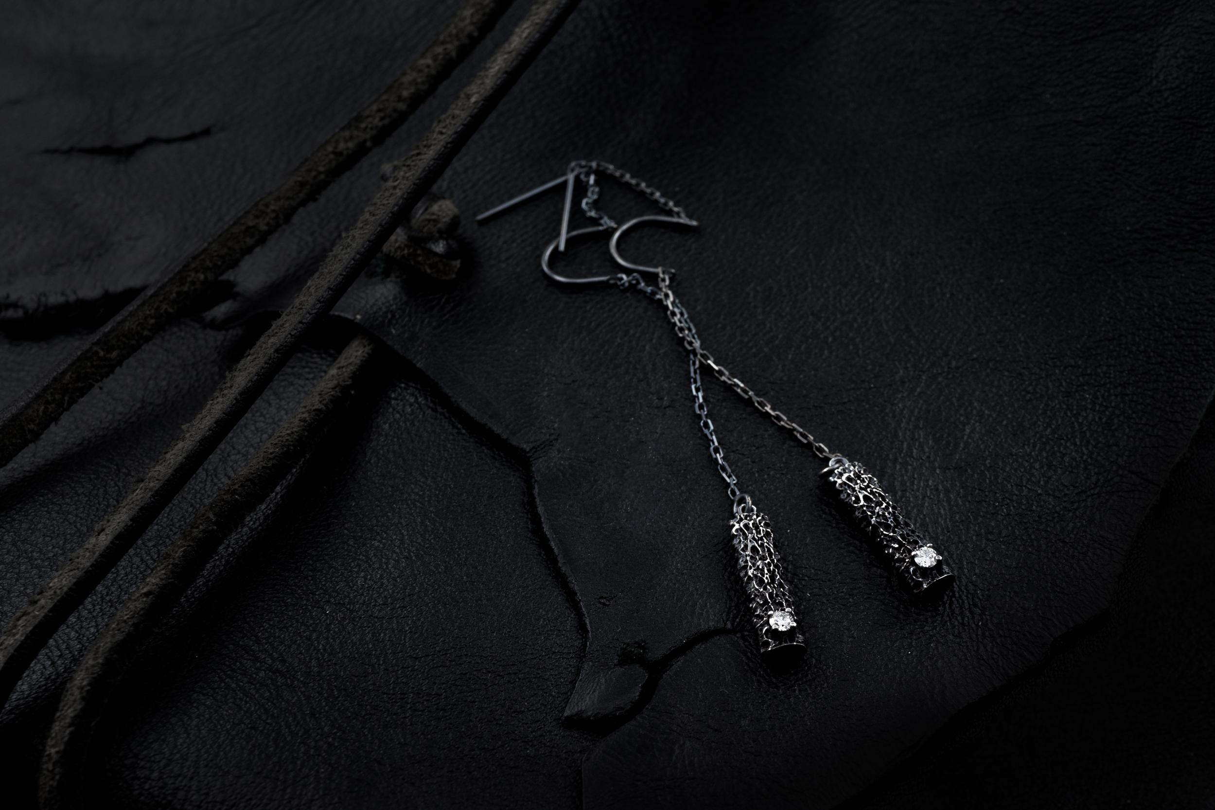 Threaded Column Earrings: Sterling silver, white diamond, patina.