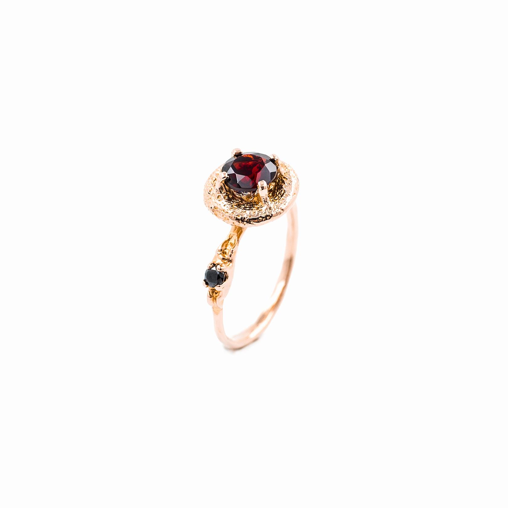 Surfacing Ring | 18ct rose gold, garnet, black diamond.