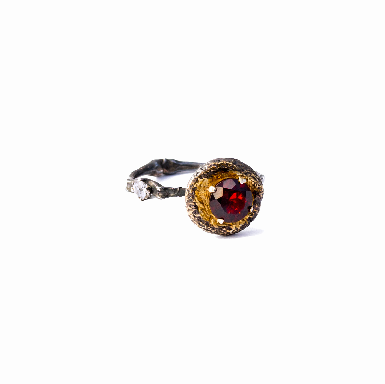 Surfacing Ring | Sterling silver, garnet, sapphire.