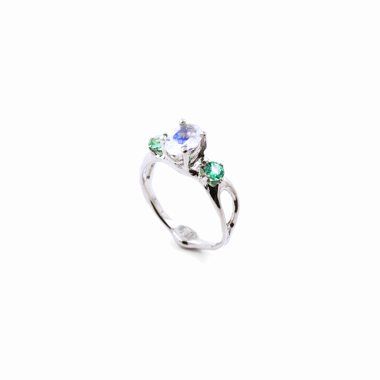 Unfolding Engagement Ring   White gold, moonstone, emeralds.