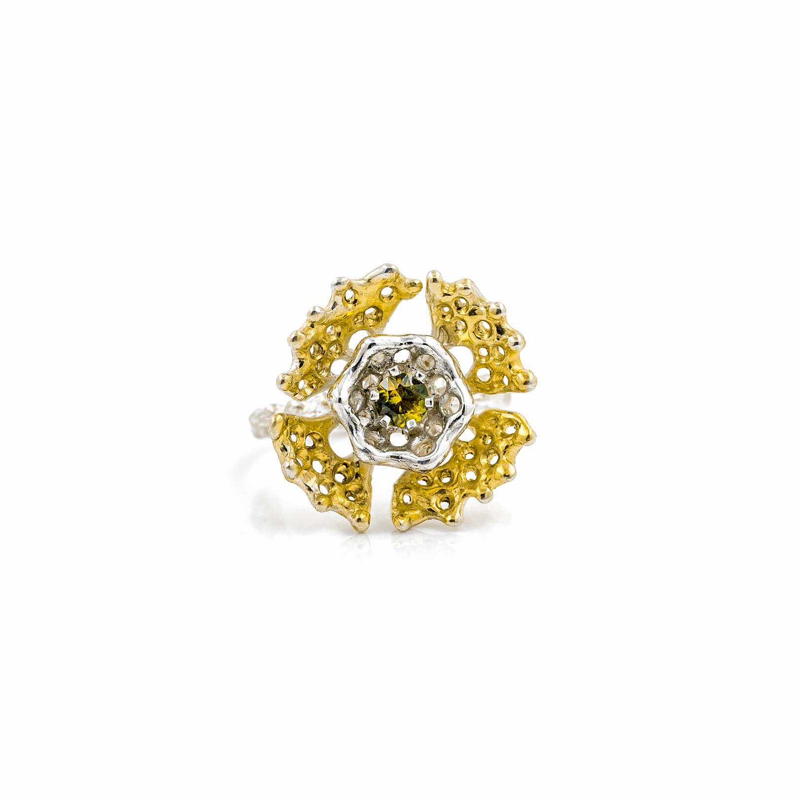 Fanned ring: Golden fans surround a stunning yellow green Australian parti sapphire.