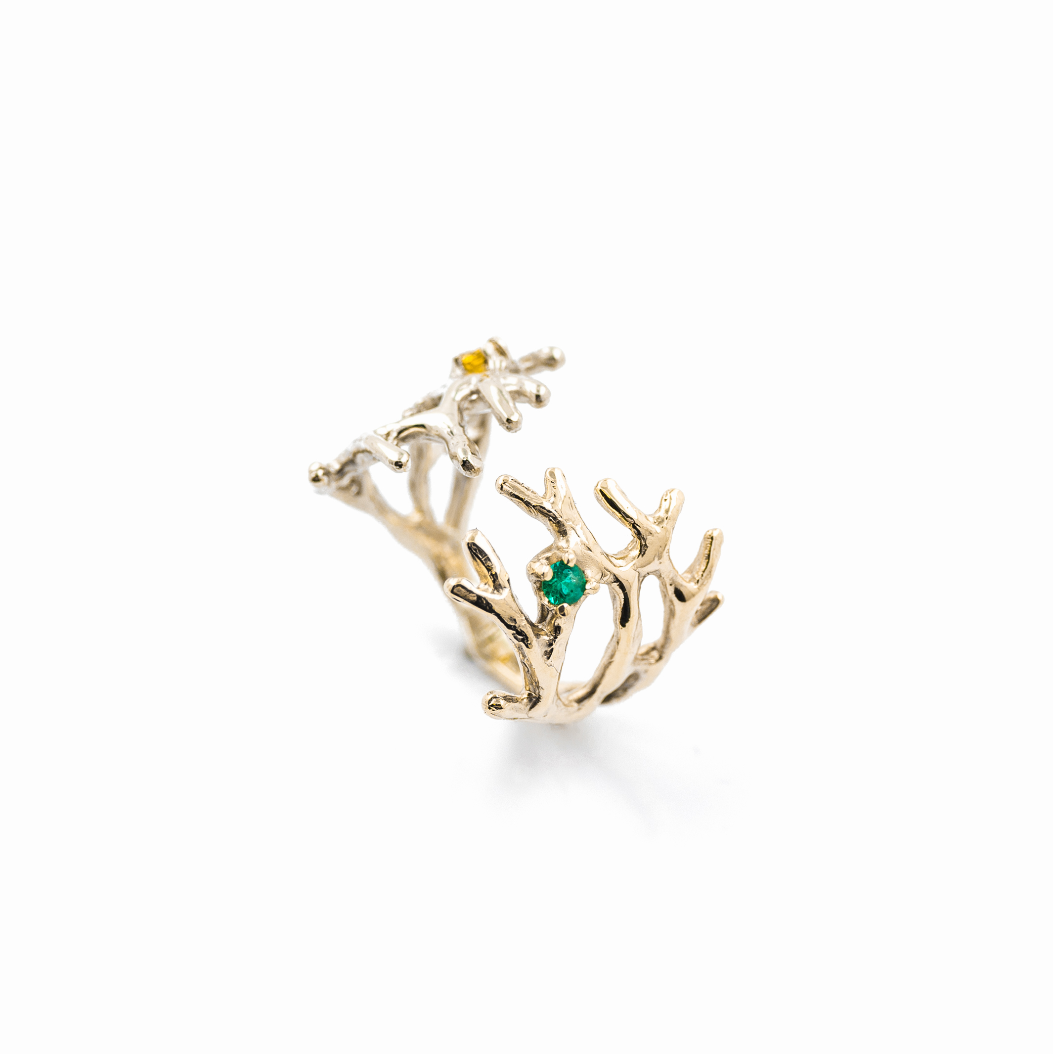 9ct white gold and yellow gold blend together to hold a yellow sapphire and bright green emerald.