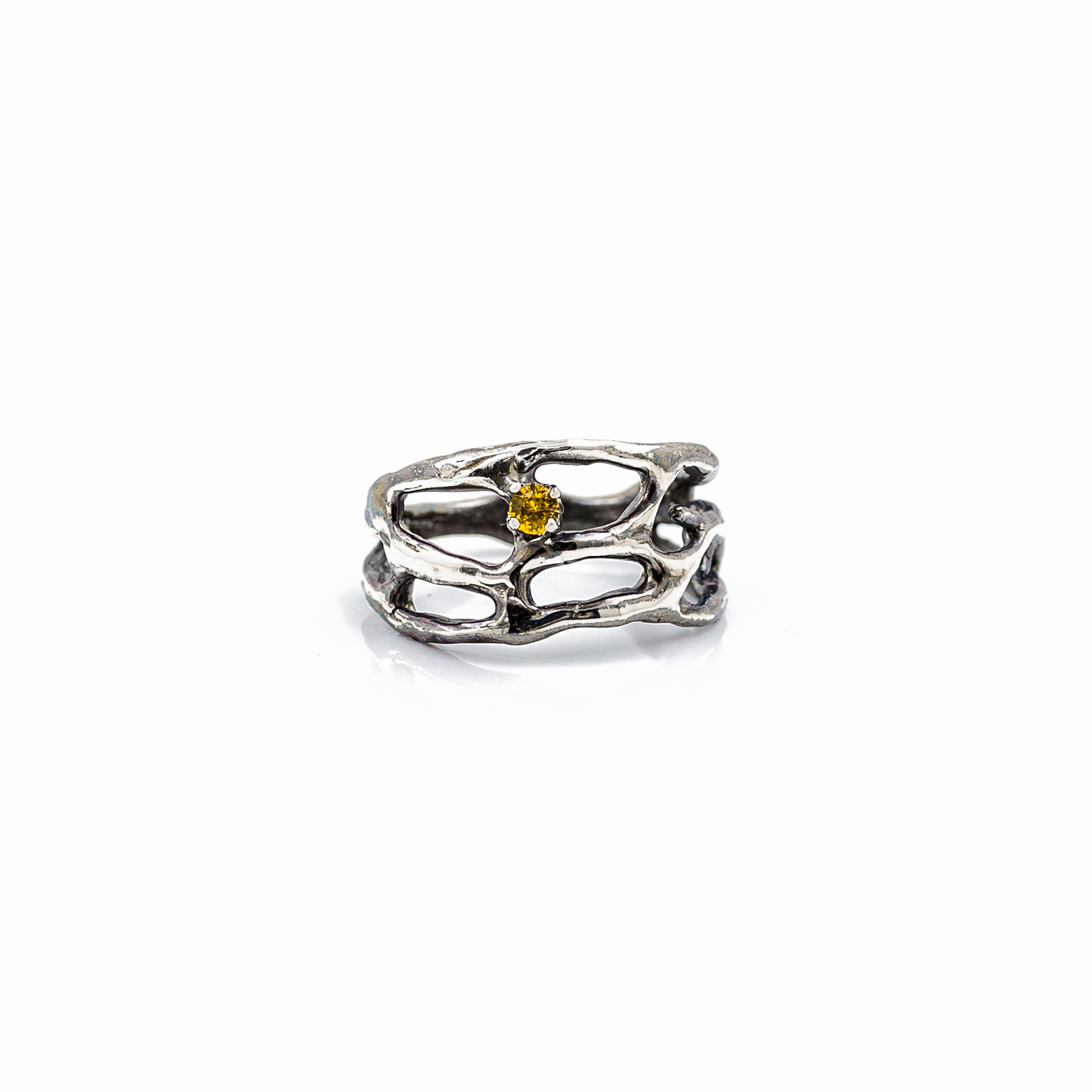 Silver branches of a Cajal ring surround a stunning yellow Australian sapphire.