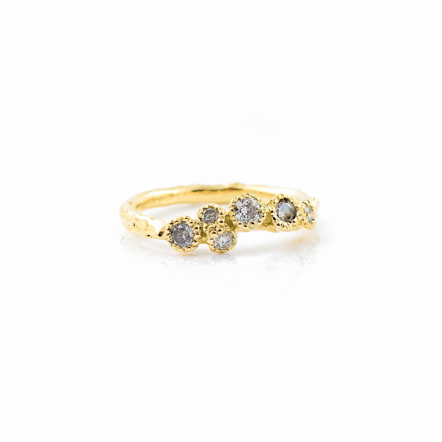 Surfacing Wedding Band   18ct yellow gold, salt and pepper diamonds, white diamonds.