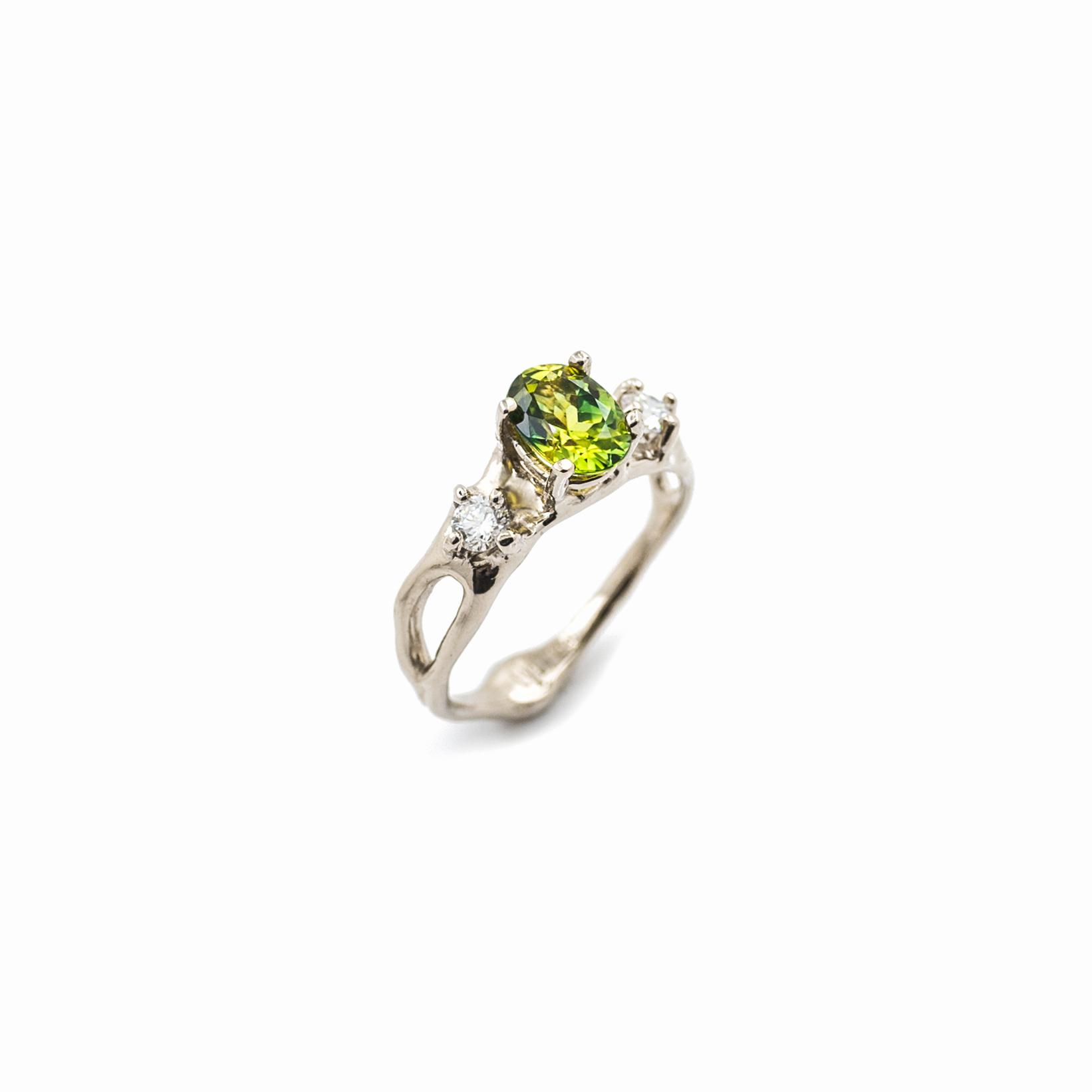 Unfolding Engagement Ring    18ct yellow gold, Australian yellow-green sapphire, white diamonds.