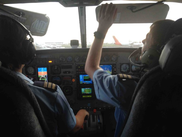 Travelling by Cessna Caravan 208B!Trying to avoid those wet season storms