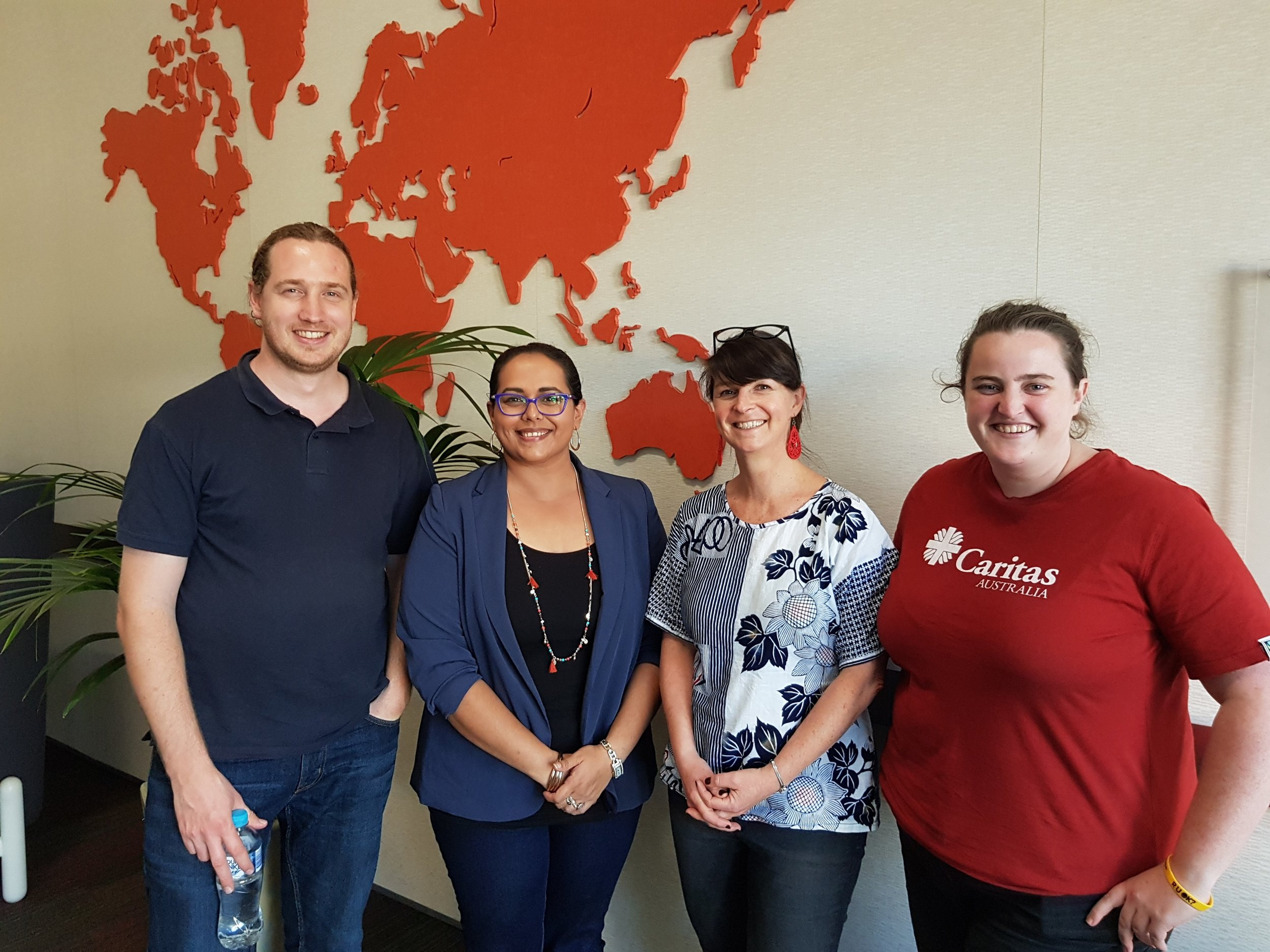 AbCF Community Development Officer Lauren Bowyer meeting with Carl, Lisa and Patrice at the Caritas Australia Sydney office.