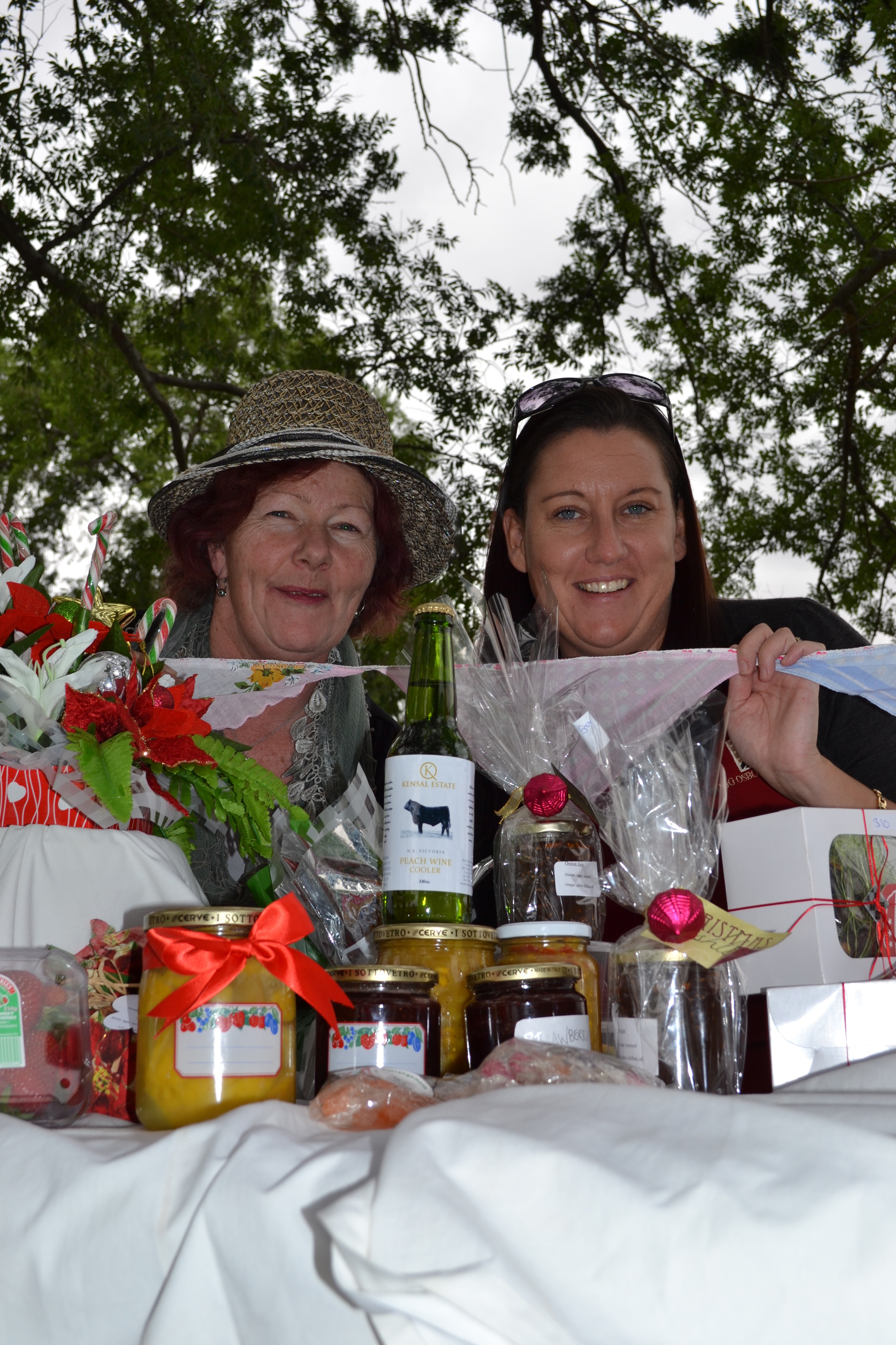 Homemade heaven: Koonoomoo Farmers' Market coordinator Kellie Byford (right) and committee member Lorraine Swanson-Hoyle show off stallholders' local products. Picture: Toni Brient.