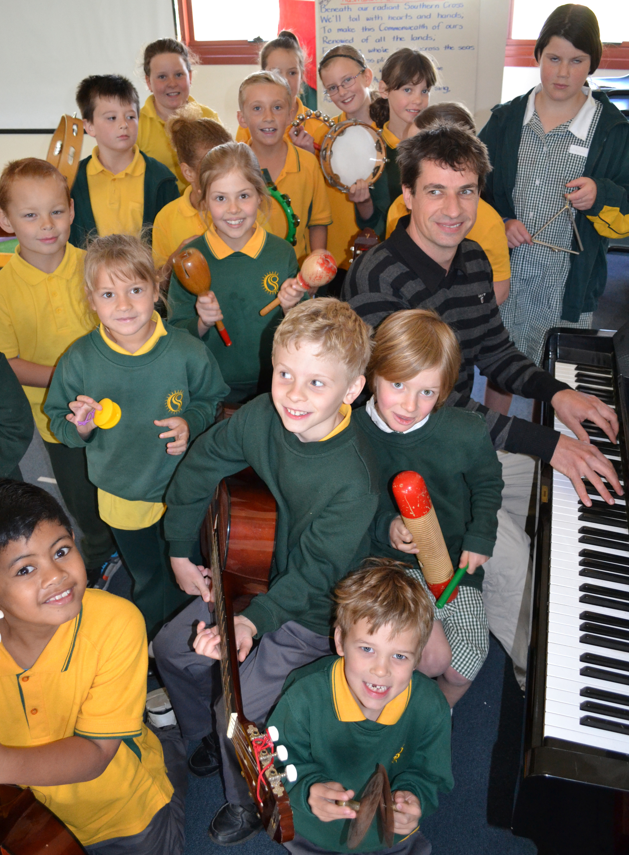 Music man: Cobram Primary School students with new music teacher Alistair Davey. Picture: Toni Brient.