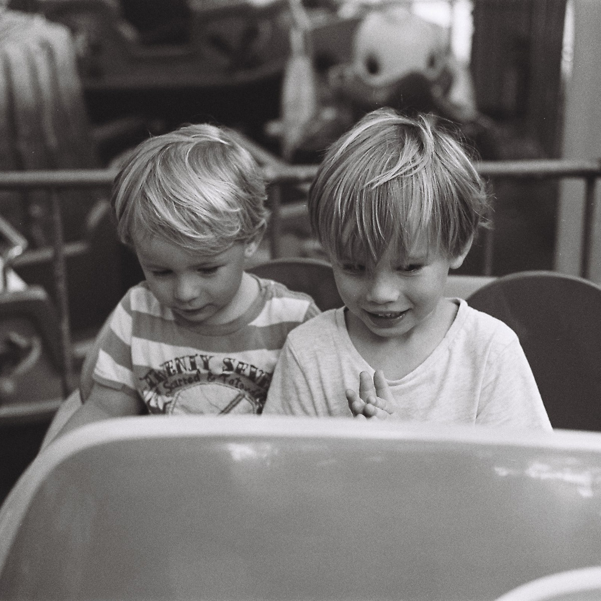 Jake and Zac enjoying a fairground ride