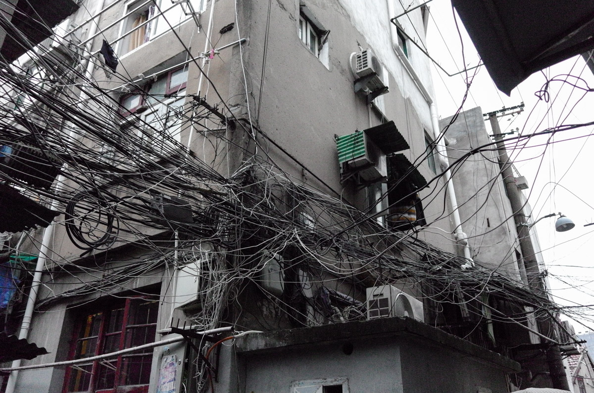 On to the old town , the poorest part of Shanghai . I believe the Electrician must turn up and think thatits easier just to fit another wire than figure out which actually has the problem