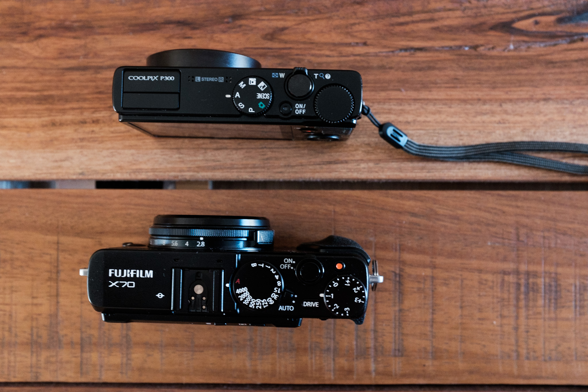 Fuji X-70 vs Nikon P300