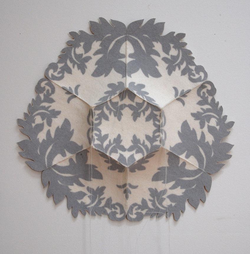 "'danja 1'  2012  13.5"" x 14"" x 1.5"" industrial felt, silkscreen printing, hand stitching"