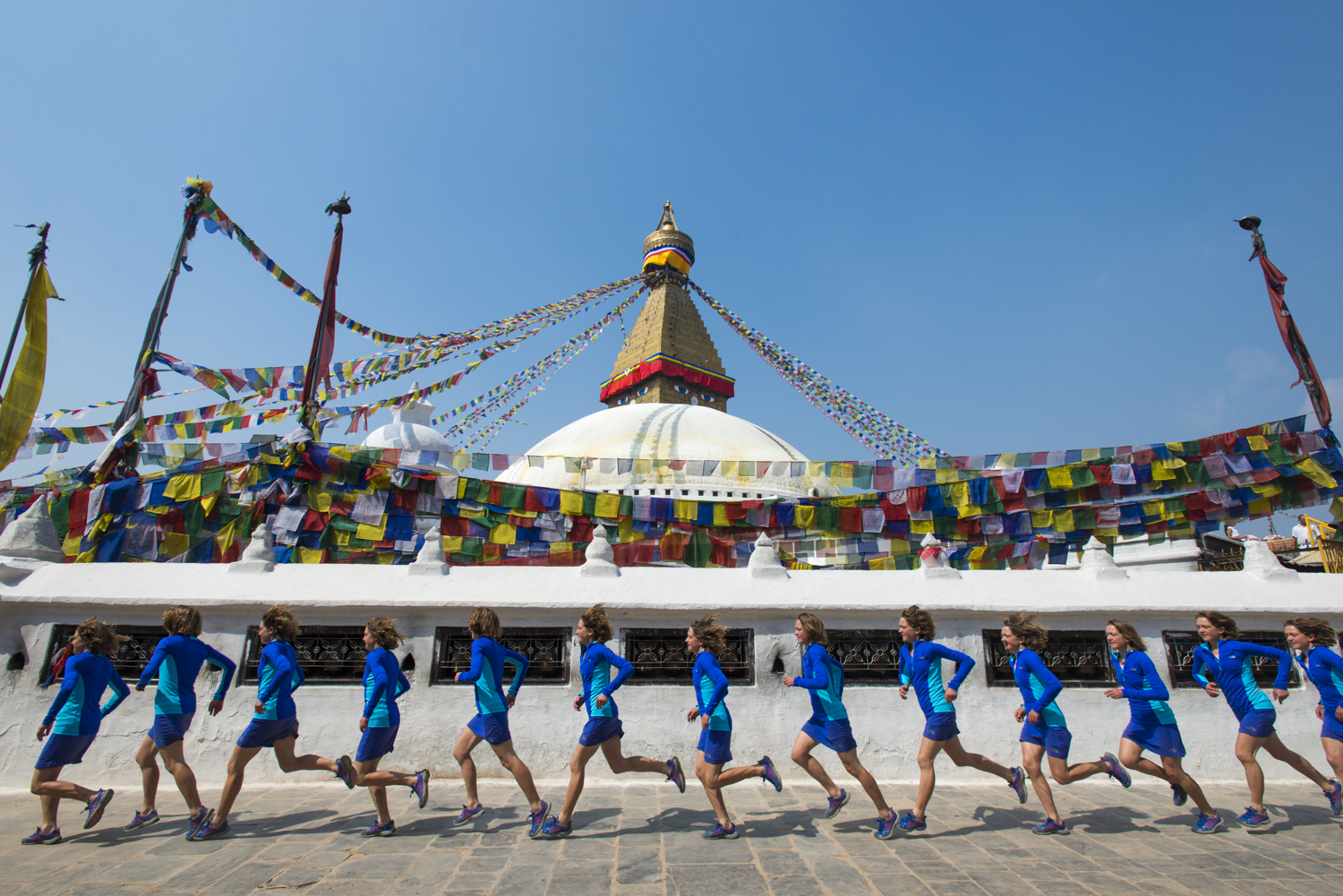 Lizzy Hawker runs around Bouddha in Kathmandu