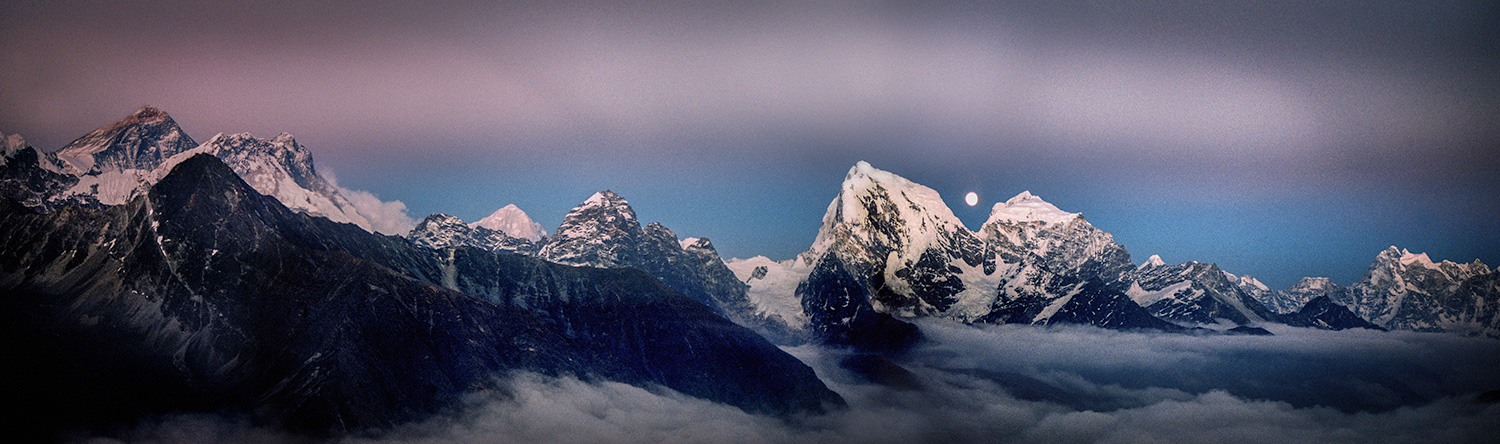 Minutes after the cloud cleared, the moon rose between Cholatse and Taboche. Everest is the far peak on the left.