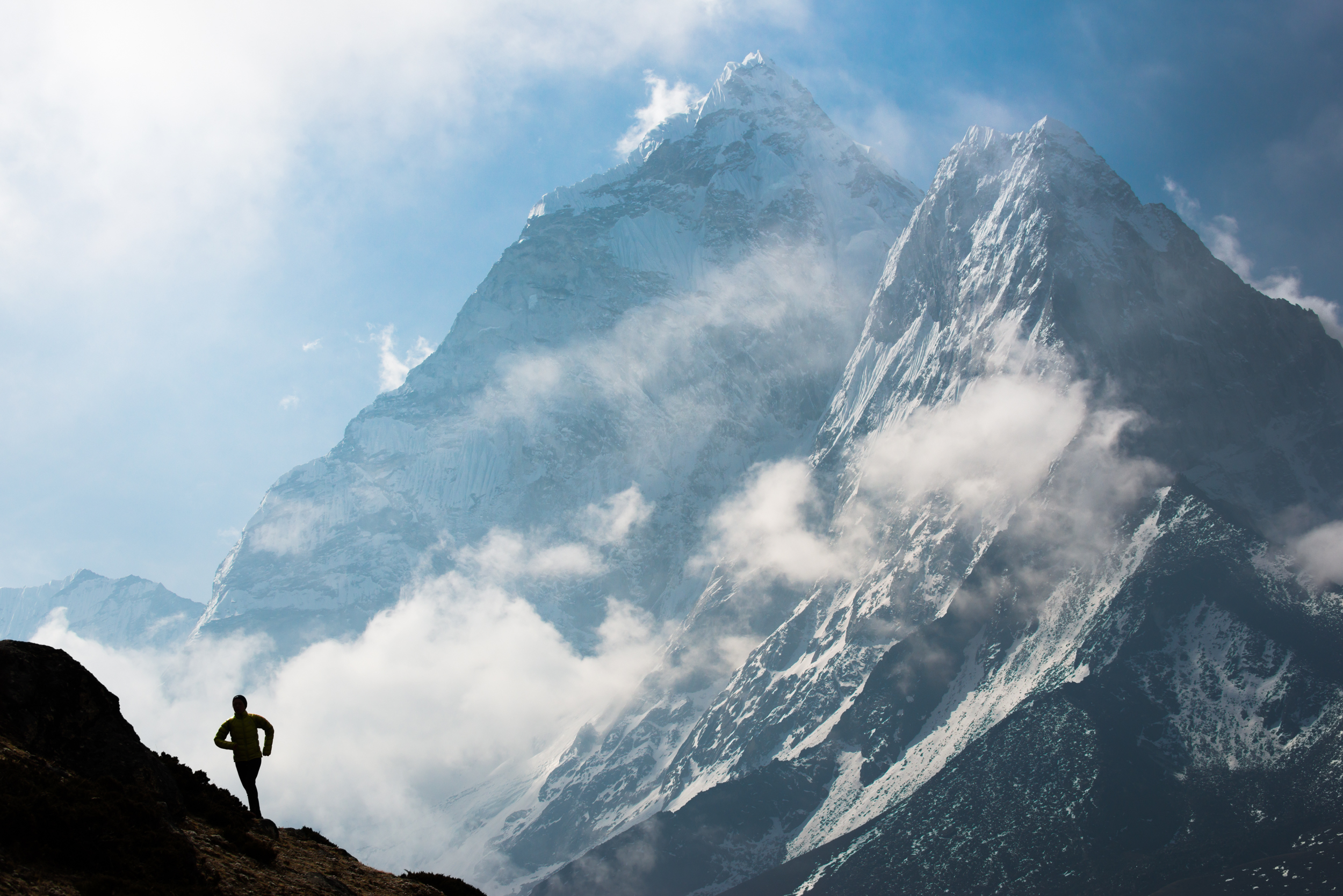 Nepal   Lizzy Hawker – the 100km world champion runner – while competing in the Everest Base Camp to Kathmandu Mailrun: A sleepless 3 day, 319km journey with over 10,000m of ascent and descent. Here Lizzy runs with with views of Ama Dablam behind