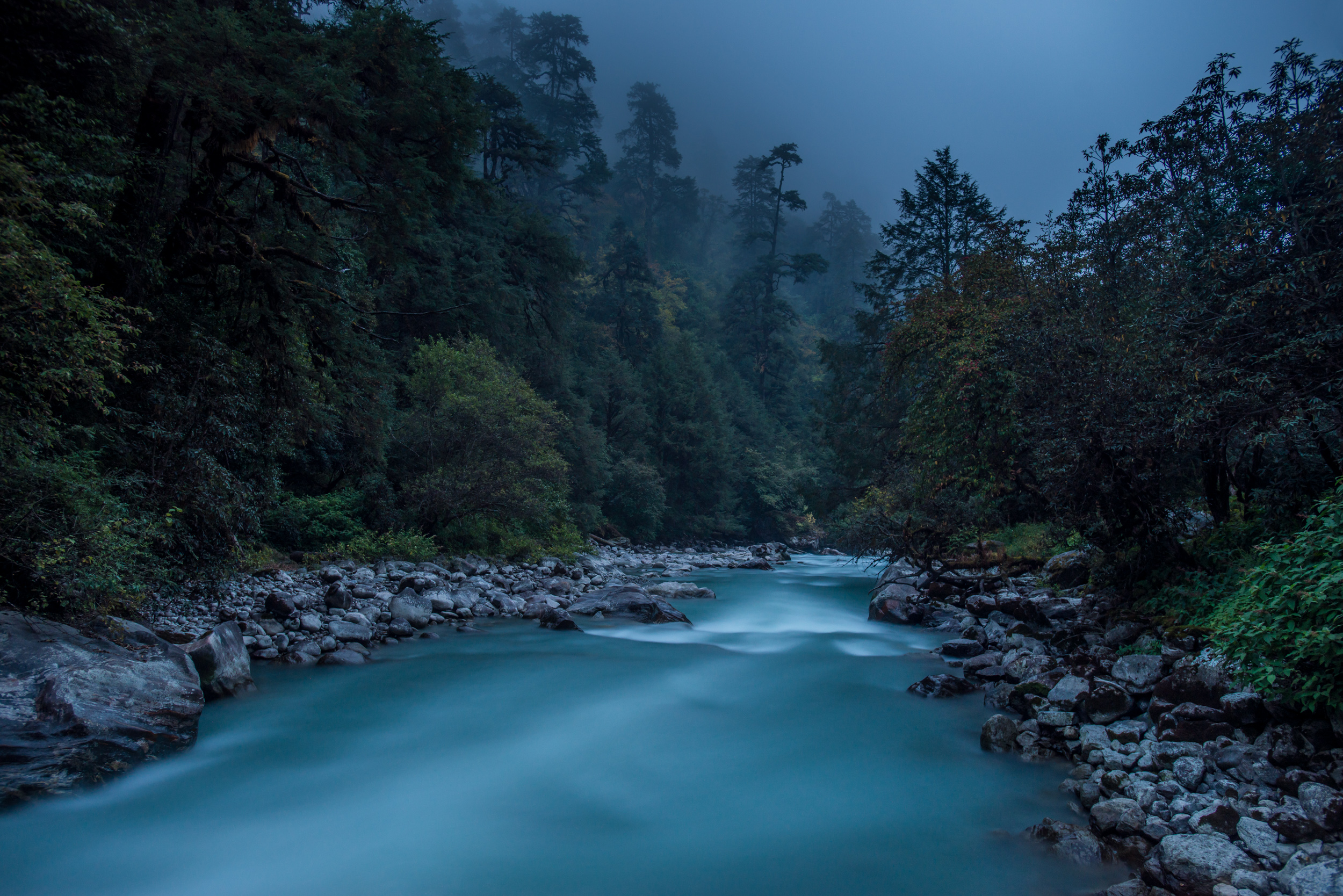 Langtang Khola near the little village of Riverside on a misty evening in the Langtang region of Nepal