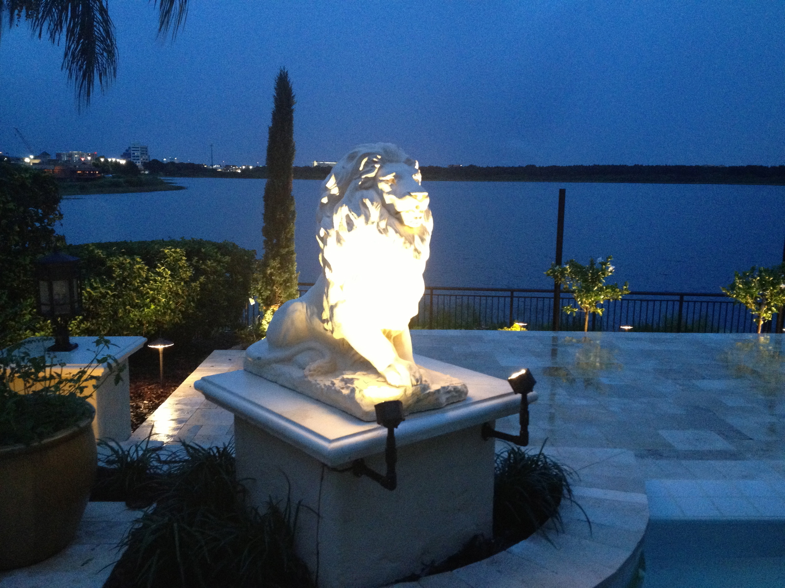 Beautiful Lion Statuary Fountains express the elegance of this Travertine Pool Deck.