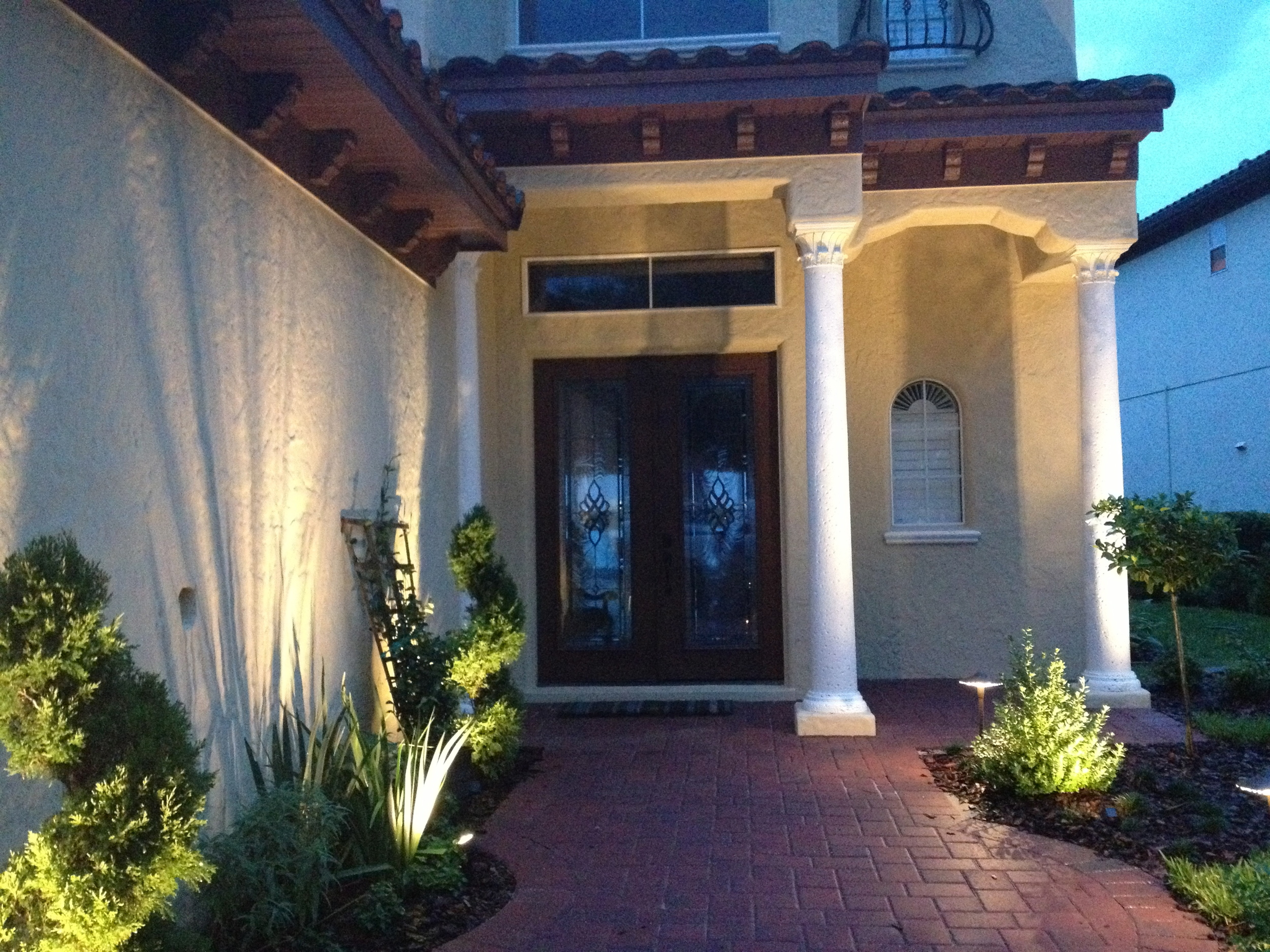 Completely Remodeled Front Entry with Landscape Lighting, New Exterior Paint for the Entire House & New Pavers
