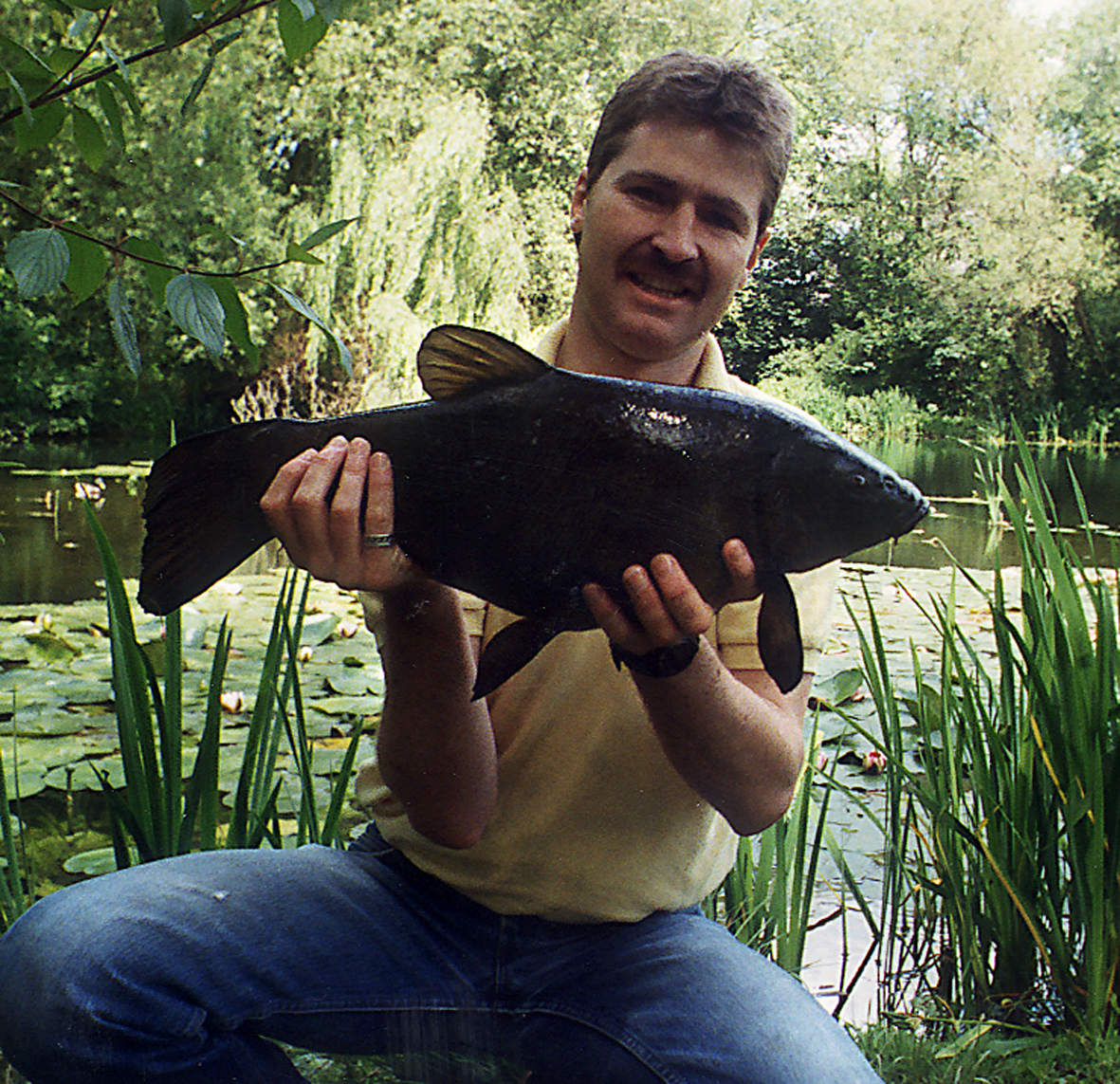 Me, when I was young! A 7lb 10oz tench caught on a single grain of corn between the lily pads.
