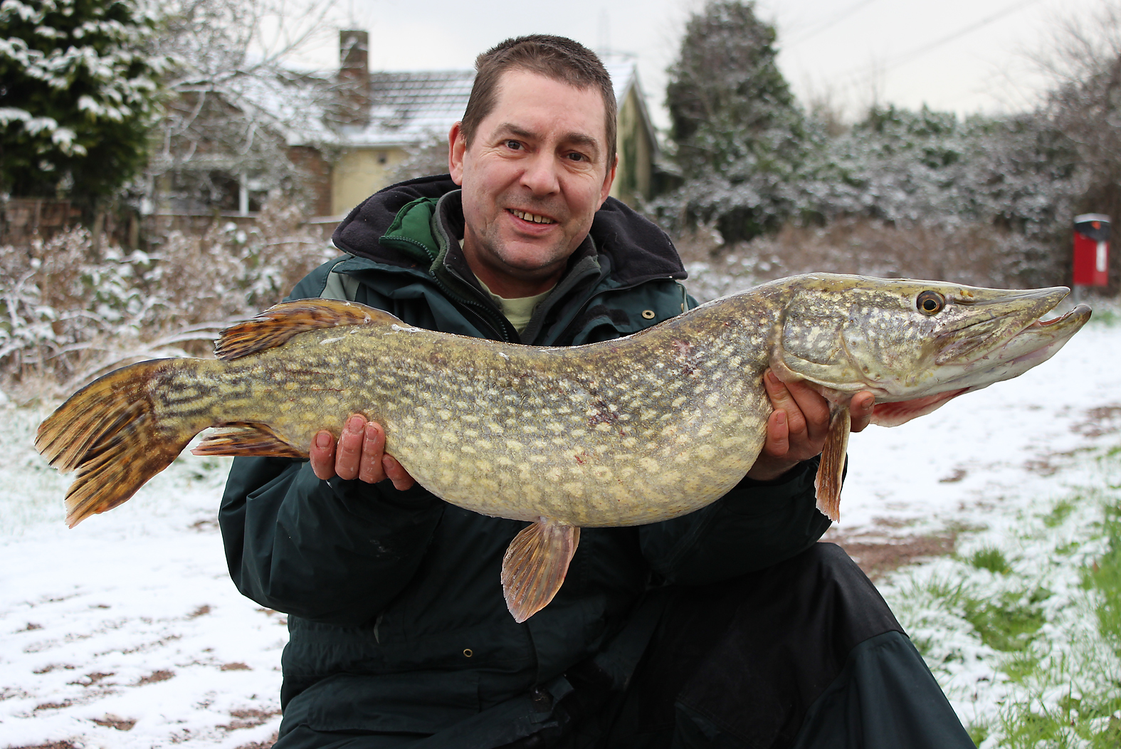 Now that's a snow fish! Gary with a 16lb'er
