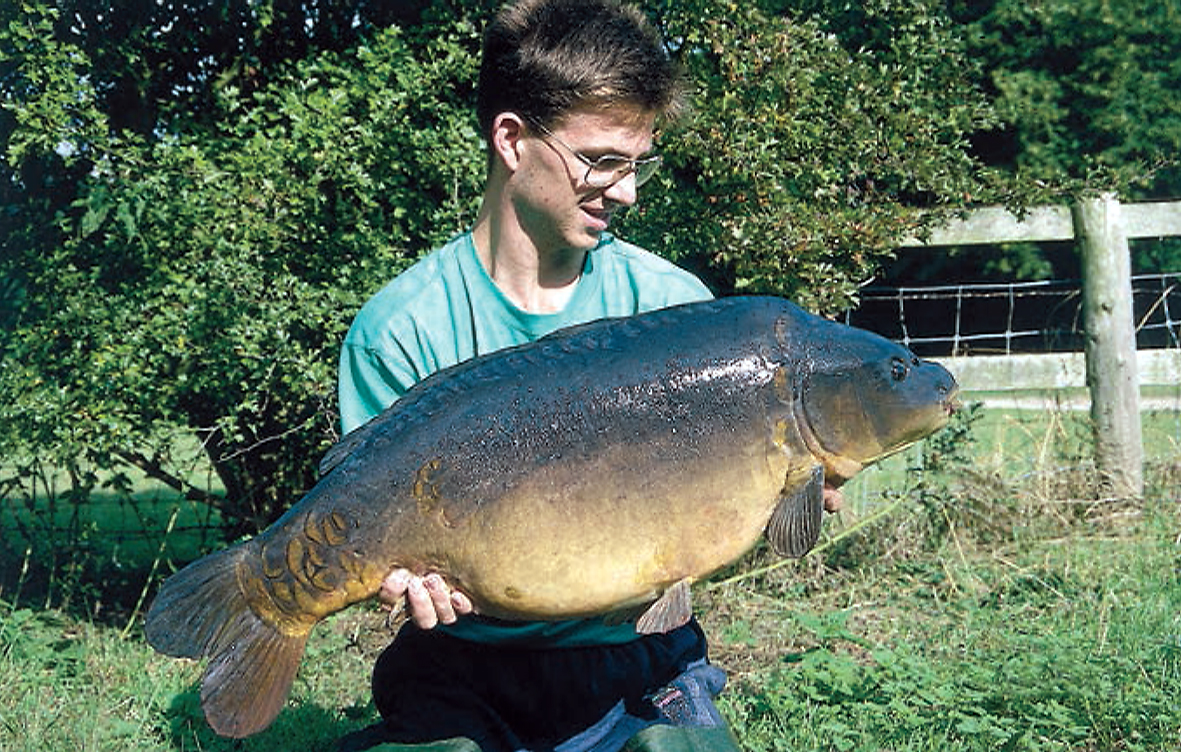 Another Frampton carp graces the bank at 34lb 8ozs, it's the 'Brown One'