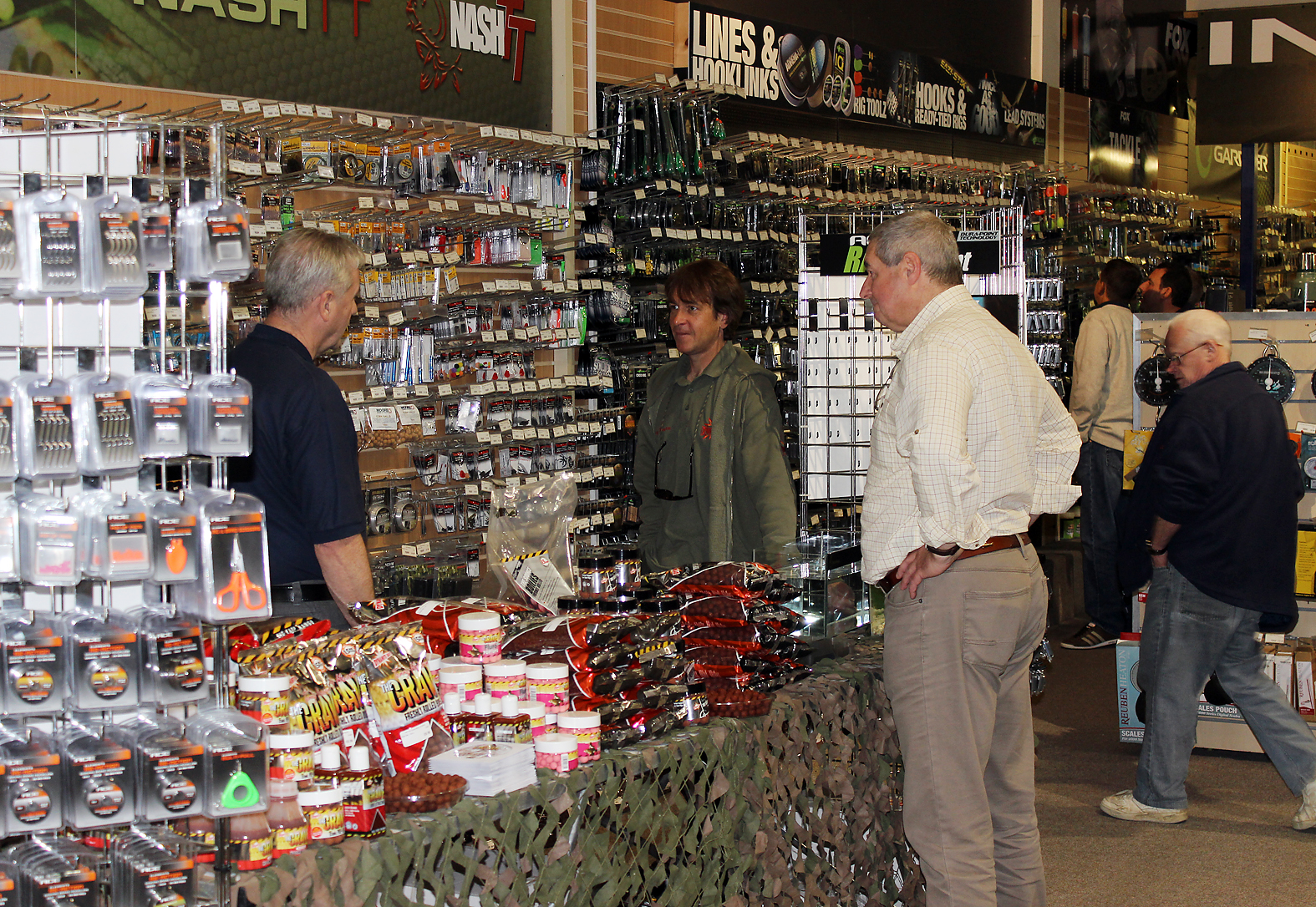 Angling Direct's star for the day, Terry Hearn (centre), gets ready for the crowds!