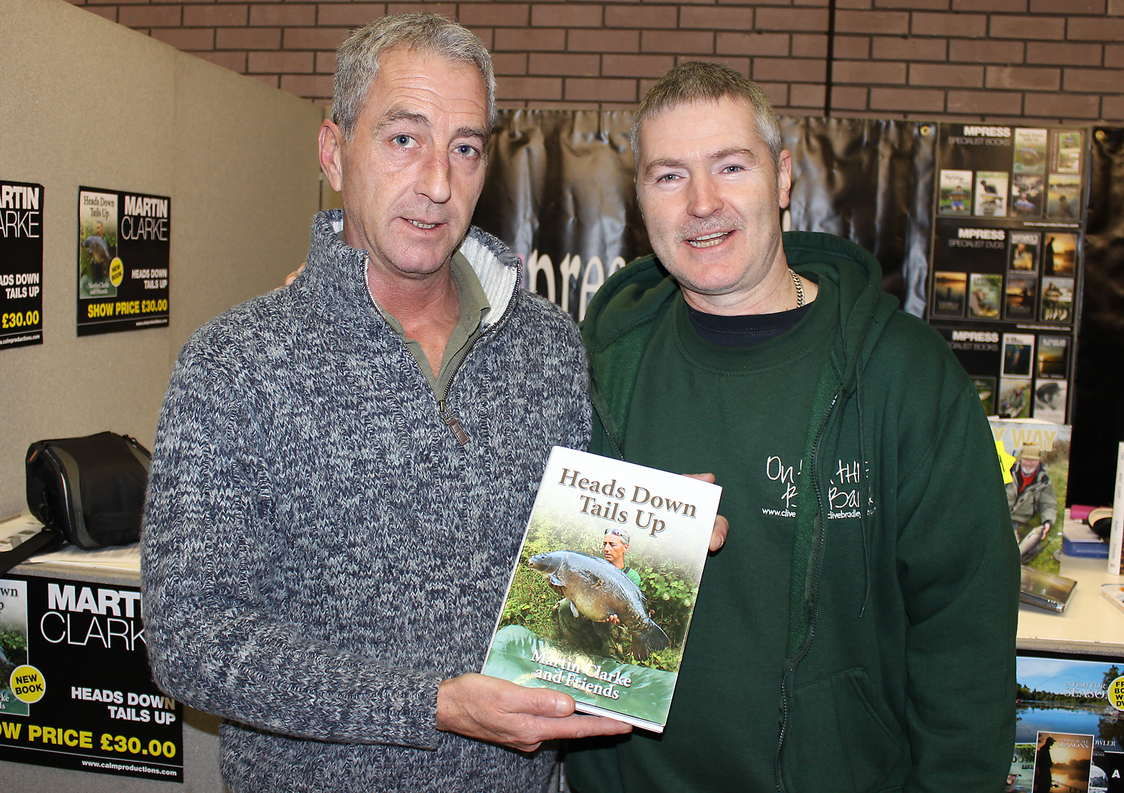 Carp angler and author Martin Clarke, showing off his latest publication