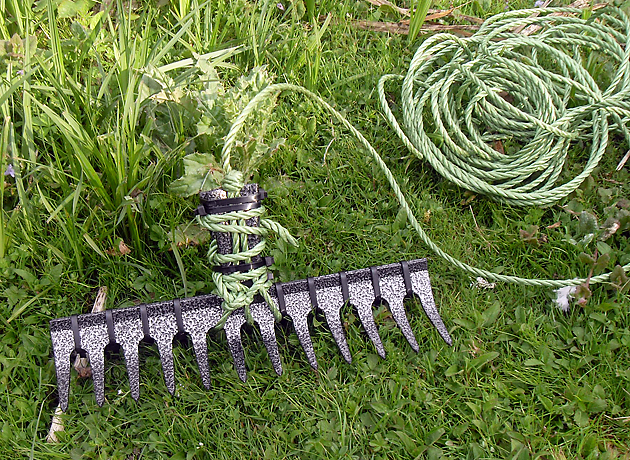 A homemade weed rake should do the business