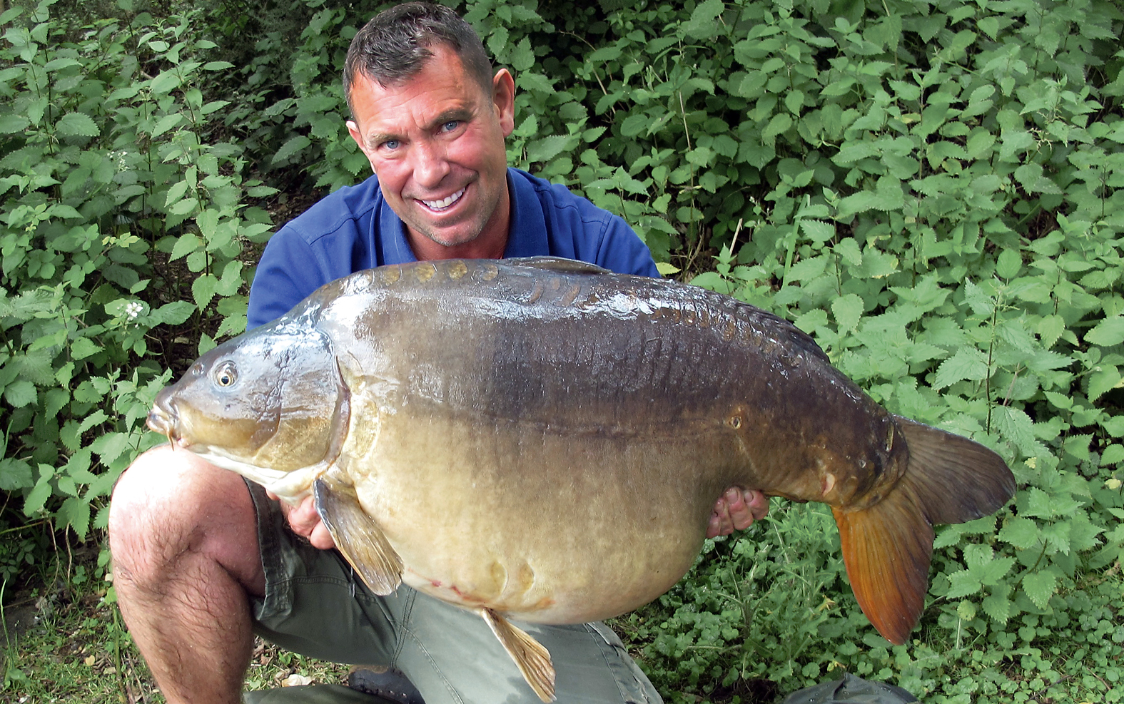 Jerry Hammond finally has the big 'un on the bank, but it wasn't easy!