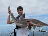 A photo of Tom Walsh with the new record spurdog at 24lb 5oz (11.056kg).
