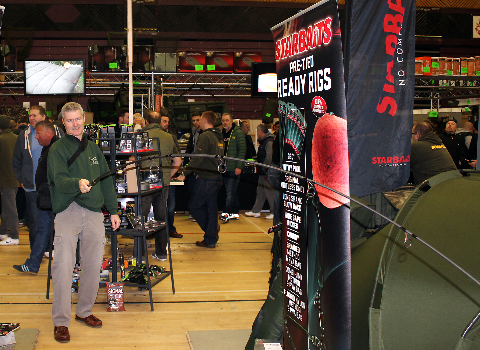 Nothing like getting a bend in your rod, I'm trying out one of the Starbaits M5 rod range at the show... please don't let go...