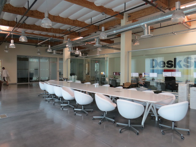 24 foot Kayak conference table in White gloss finish, installed at Desksite in Irvine, CA.