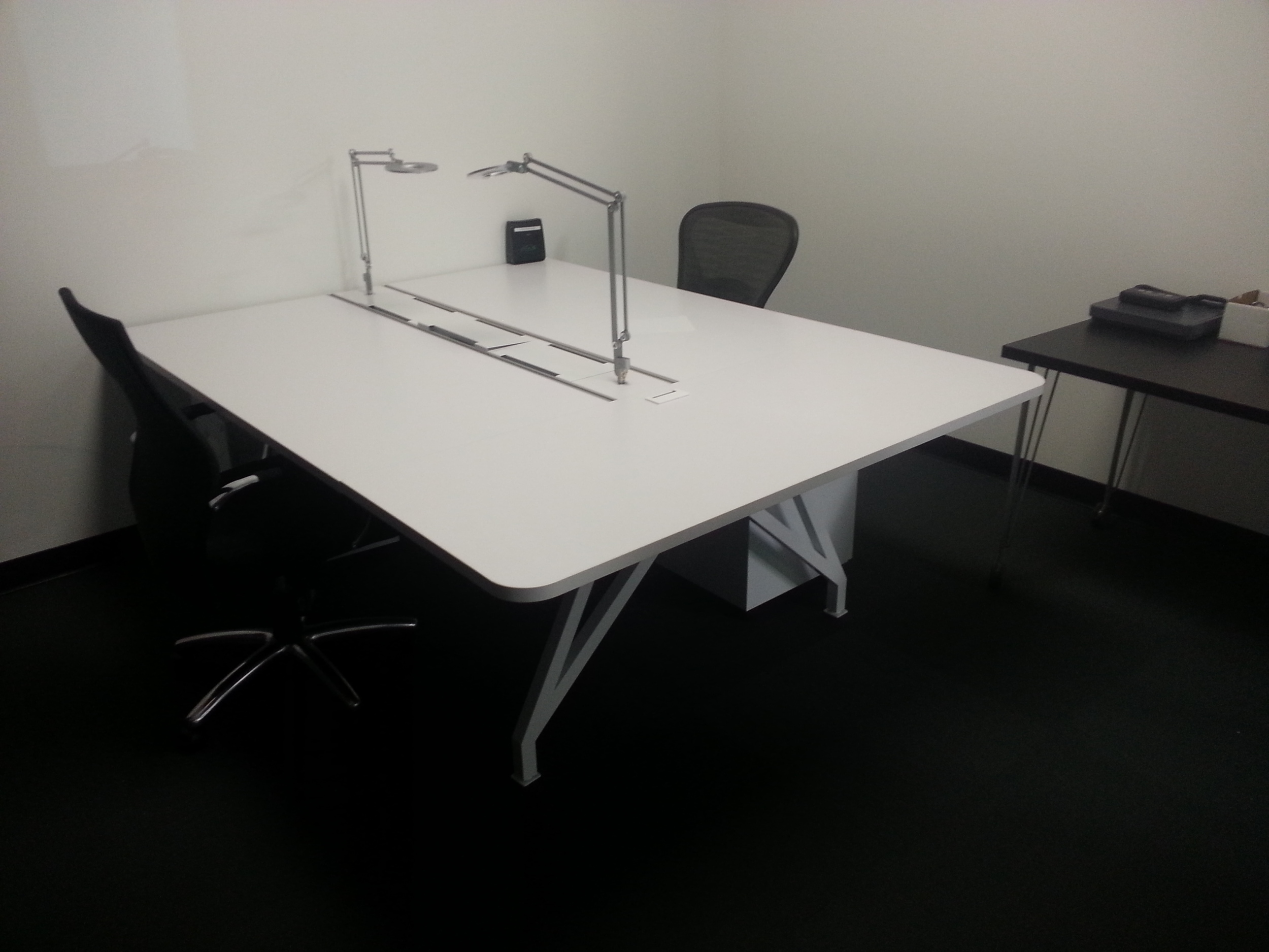 white Corporate office  desk installation set people two sides