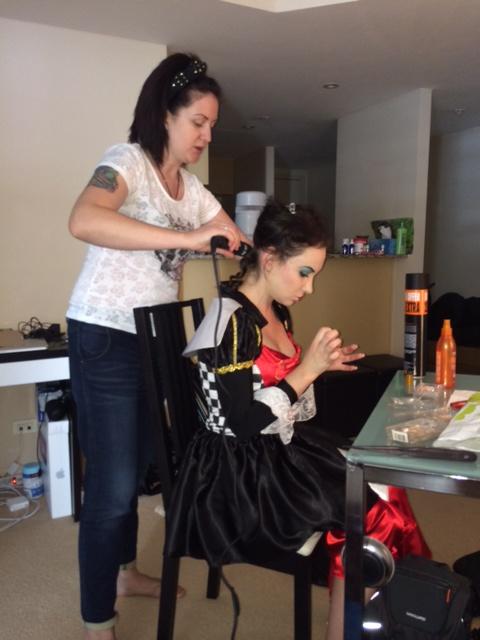 Elena working the hair curlers