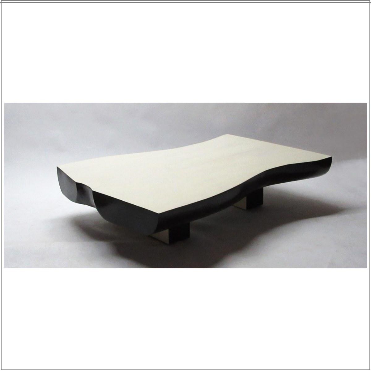 sculptured laminated slab cocktail table