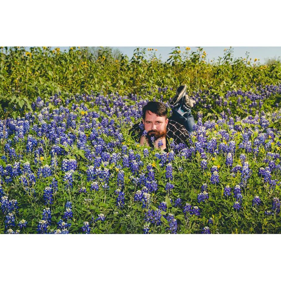 A rare photo of me, in the bluebonnets.  Probably one of the best photos of me every taken...