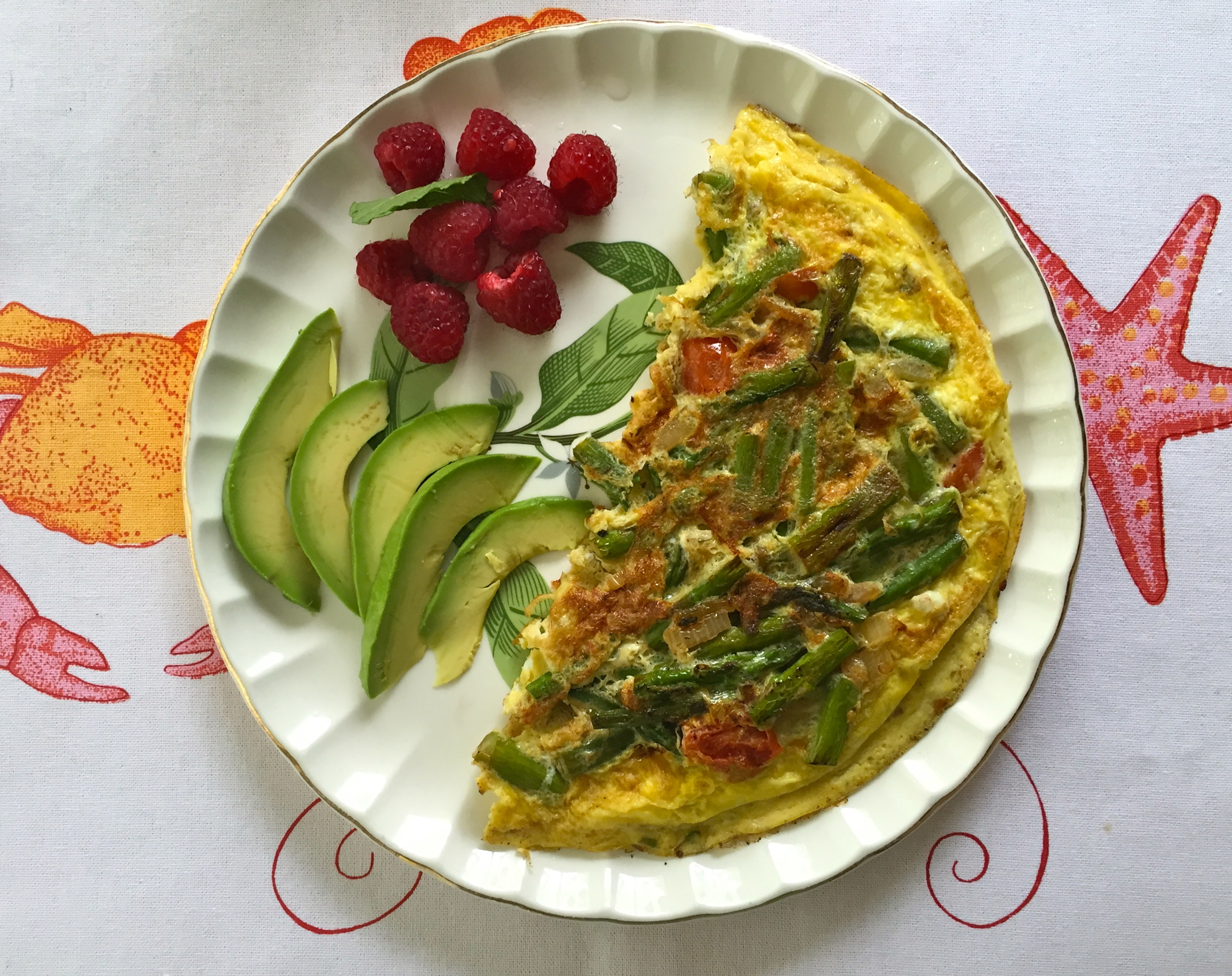 One of the best parts about being home? Mom cooking for me! Veggie omelette with asparagus and tomato, plus a side of avocado and raspberries.