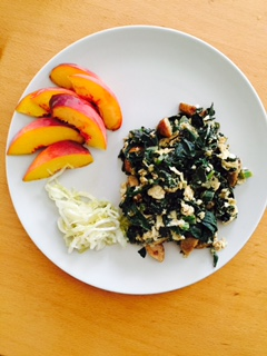 Mostly kale scramble with sausage, kraut, and peaches