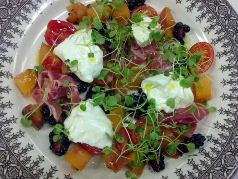 A dish featured in the cookbook: NJ Peach and Burrata Salad (Chef Jeremy Einhorn)