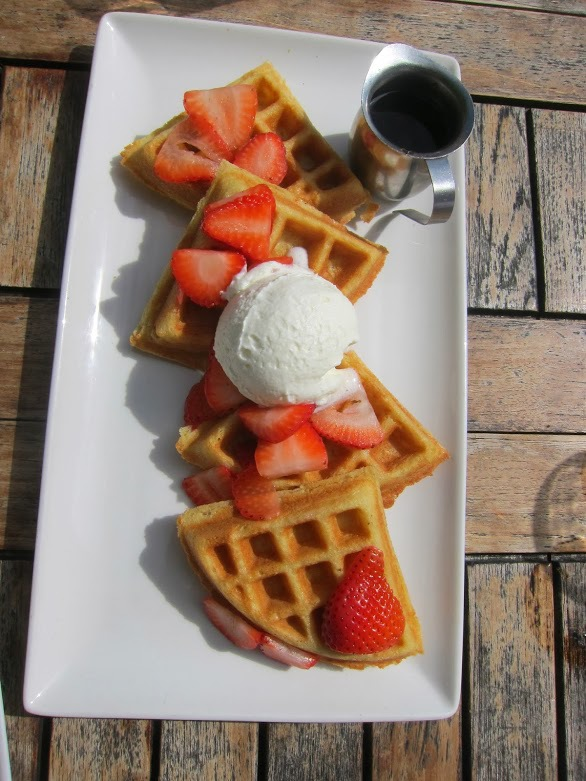 Big Ol' Waffle - Fresh Florida strawberries n' whipped cream, Bourbon maple syrup