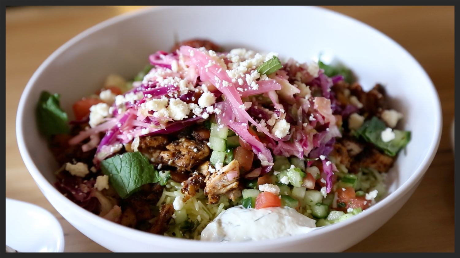 Pictured:  Rice bowl with Chicken, Cucumber, Cabbage Slaw, and Feta from  Cava Mezze Grill  |  Foodable WebTV Network